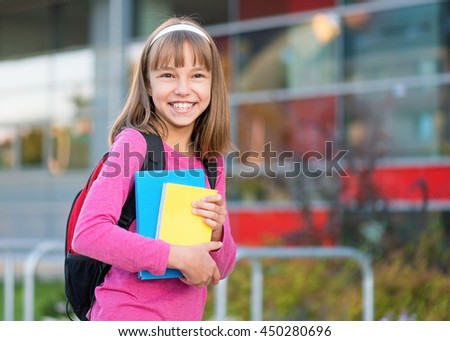 Little students with books - outdoor portrait. Beginning of class after vacation. Back to school concept. - stock photo