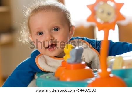 little sweet baby in the baby walker - stock photo