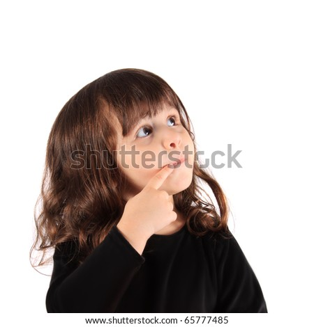 Little three year old brunette little girl holding her finger close to her nose with a thinking expression with copy space - stock photo