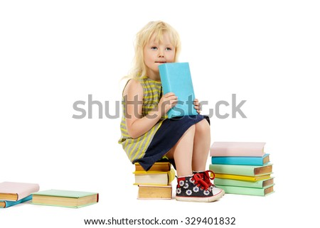 Little three year old girl sitting with piles of books and dreamily thinking. Education. Isolated over white. - stock photo