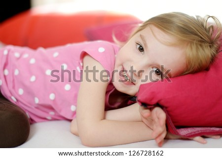 Little toddler girl in pajamas on sunny morning - stock photo