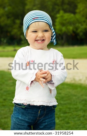 Little toddler girl laughing - stock photo