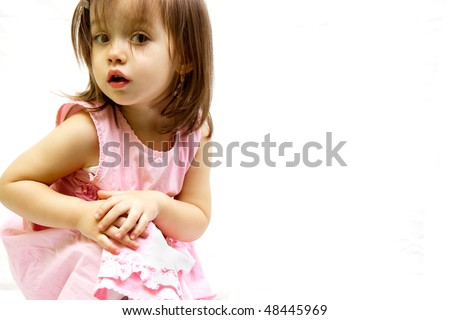 little toddler girl posed in a pink dress - stock photo