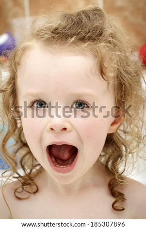 Little toddler laughing in the bath - stock photo