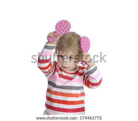 little toddler playing with make-up toys - stock photo