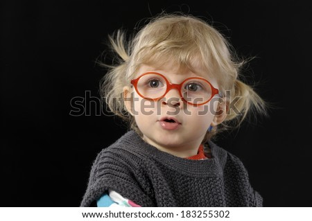 little toddler with glasses on black