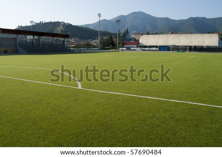 Little town soccer field stadium in plastic grass - stock photo