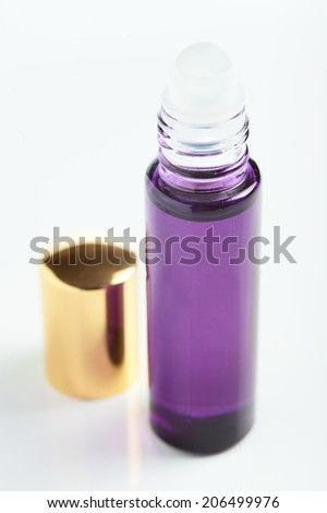 little transparent and cute perfume bottle on white background