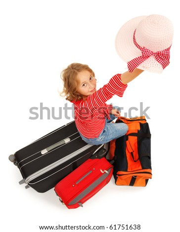 Little traveler girl waving with her hat - stock photo