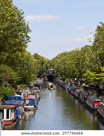 Little Venice in London In Maida Vale two canals join and form a basin that is known as Little Venice. Here people have made a home living on narrow boats. The canals are still in operation. - stock photo