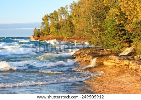 Little waterfall pours into Lake Superior at Pictured Rocks National Lakeshore - stock photo