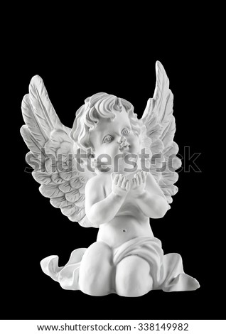 Little white guardian angel isolated on black background. Vintage style christmas decoration - stock photo