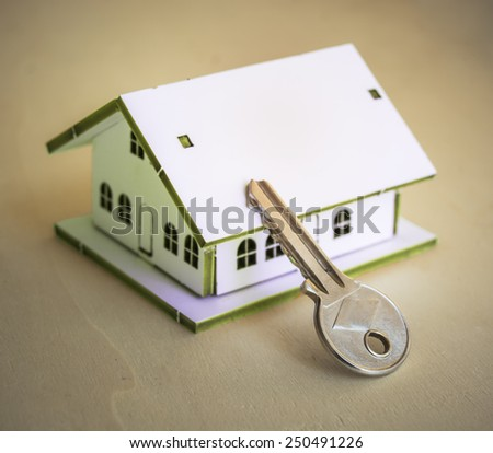 Little White House and Key - stock photo