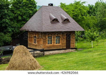 Little wooden house. Traditional Romanian Village House.Old village house