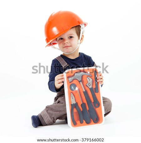 Little worker in orange helmet with tools kit on white - stock photo