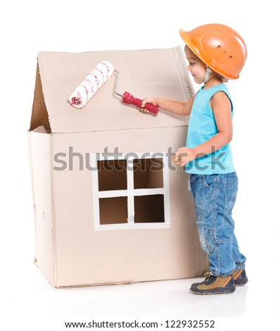 Little worker with paint roller and house. Isolated on white - stock photo