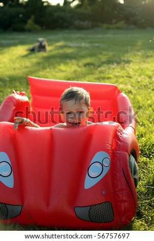 Little 2 years old boy playing in the swimming pool outdoor. Summer enjoying with water - stock photo