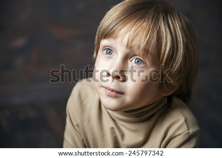 Little young beautiful boy spiritual peaceful praying and wishing, horizontal, copy space. - stock photo