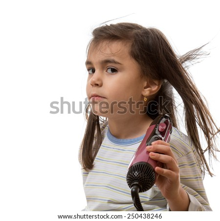 little young girl drying hair with hairdryer - stock photo