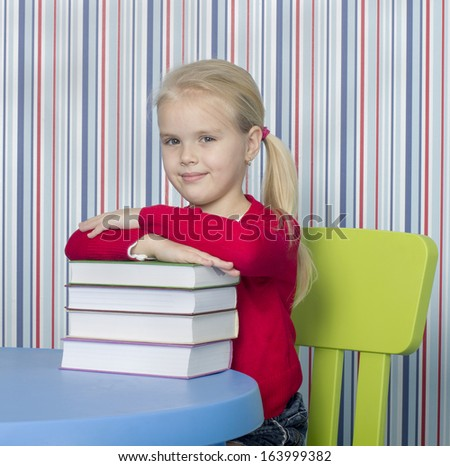 little young girl read the book