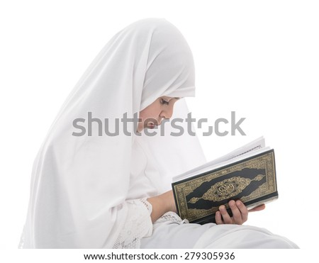 Little Young Muslim Girl Reading Quran Holy Book Isolated on White Background - stock photo