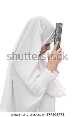 Little Young Muslim Girl With Quran Isolated on White Background - stock photo