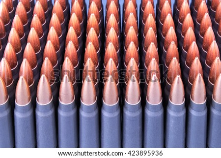 Live ammunition for automatic weapons or rifles ranked closeup.  - stock photo