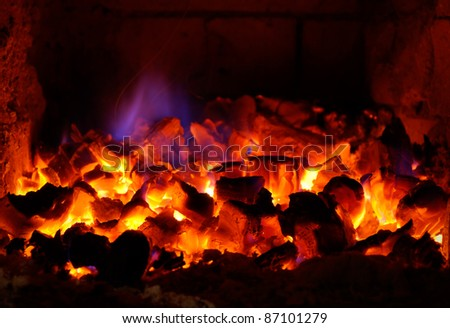 live coals in the stove - stock photo