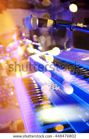 Live music background.Concert and music festival.Instrument on stage and band.Stage lights.Abstract musical background.Playing keys and concert concept - stock photo