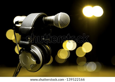 live music  background.Headphones and microphone on the stage - stock photo