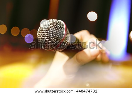 Live music background.Karaoke and microphone concept.Stage lights and singer