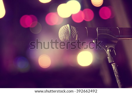 Live music background.Microphone and stage lights - stock photo