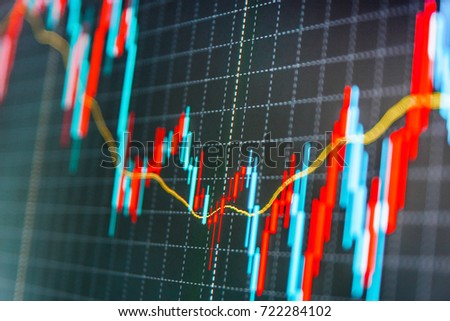 Live stock trading online. Macro close-up. Currency trading theme. Finance background data graph. Data on live computer screen. Blue background with stock chart. Blue screen of finance data.