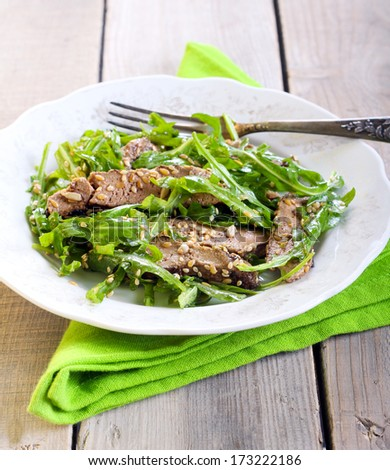 Liver and rocket salad with seeds