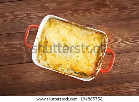 liver Lasagna  in ceramic casserole dish, close up - stock photo