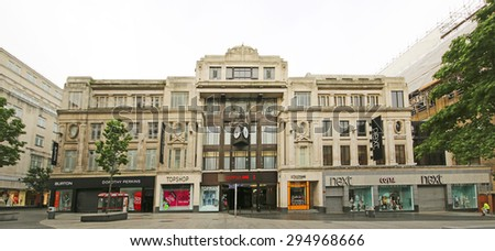 LIVERPOOL, ENGLAND - JULY 5, 2015: Retail stores. Liverpool ONE, in the heart of the city, is the huge open-air shopping district that is home to more than 160 famous high street and designer names - stock photo