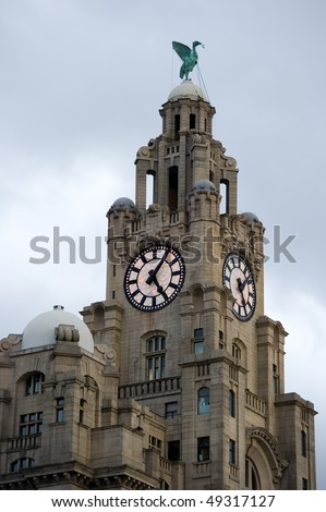 Liverpool liver building as the lights come on on the clock face with copy space.