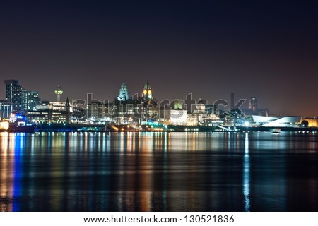 Liverpool reflecting on the river Mersey by night - stock photo