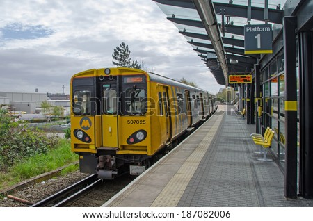 LIVERPOOL UK, APR 9, 2014: Train at Sandhills Station. The Merseyrail Network provides services across the Merseyside area. - stock photo