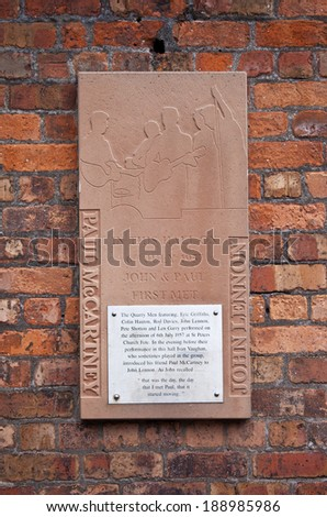 LIVERPOOL, UK - APRIL 16TH 2014: A plaque on St. Peters church hall recalling the first meeting of John Lennon and Paul McCartney (the founding members of The Beatles) in Liverpool on 16th April 2014. - stock photo