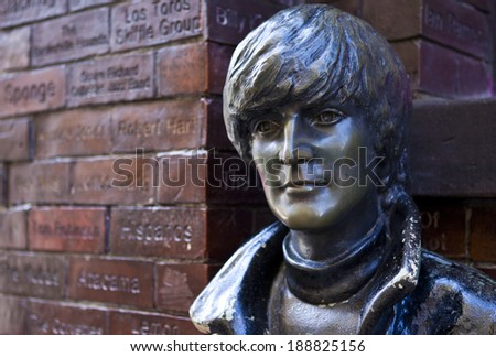 LIVERPOOL, UK - APRIL 18TH 2014: A statue of John Lennon situated opposite the historic Cavern Club in Liverpool on 18th April 2014. - stock photo