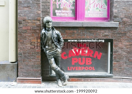 LIVERPOOL, UK - JUNE 8, 2014: A statue of John Lennon situated at Mathew Street opposite the historic Cavern Club in Liverpool  - stock photo
