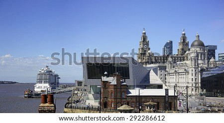 LIVERPOOL, UK - JUNE 30, 2015: Liverpool skyline from the Docks. The Albert Dock is a major tourist attraction in the city and the most visited multi-use attraction in the UK, outside of London. - stock photo