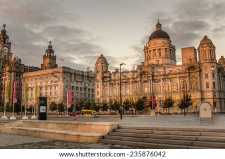 Liverpool, Uk - October 1, 2014: Port of Liverpool Building and Cunard Building at Sunset. Located on the Pier Head, an Unesco World Heritage Site, they are two of the famous Three Graces. - stock photo