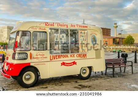 Liverpool, UK - October 1, 2014: Vintage ice cream van at Albert Dock. The Albert Dock is a major tourist attraction in the city and the most visited multi-use attraction in the UK, outside of London. - stock photo