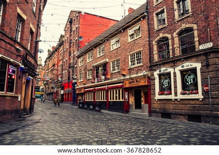 LIVERPOOL, UK - SEPTEMBER 6, 2014: Old red brick buildings in the city center. Restaurants, bars and shops. Vintage street - stock photo