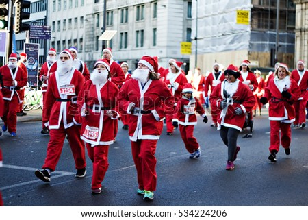 LIVERPOOL UK, 4TH DECEMBER 2016. Runners taking part in the annual 5k Santa Dash for charity on the streets of Liverpool