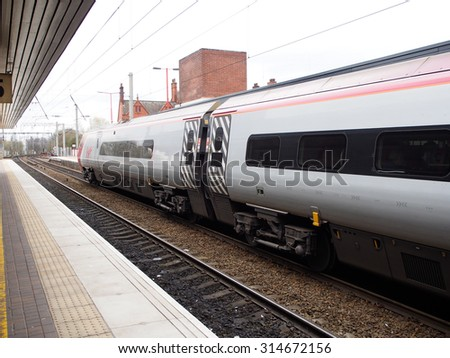 LIVERPOOL, UNITED KINGDOM - APRIL 13, 2015: high speed train at a local train station in Liverpool, UK. There were 1.65 billion journeys on the United Kingdom National Rail network in 2014.
