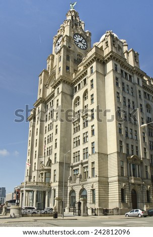 "LIVERPOOL, UNITED KINGDOM - JUNE 23: exterior of the Royal Liver Building on June 23, 2014 in Liverpool, United Kingdom. The Royal Liver Building is one of ""Three Graces"" at the waterfront.  - stock photo"