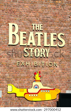 LIVERPOOL, UNITED KINGDOM - JUNE 11, 2015 - The Beatles Story exhibition building and yellow submarine at Albert Dock, Liverpool, Merseyside, England, UK, Western Europe, June 11, 2015. - stock photo